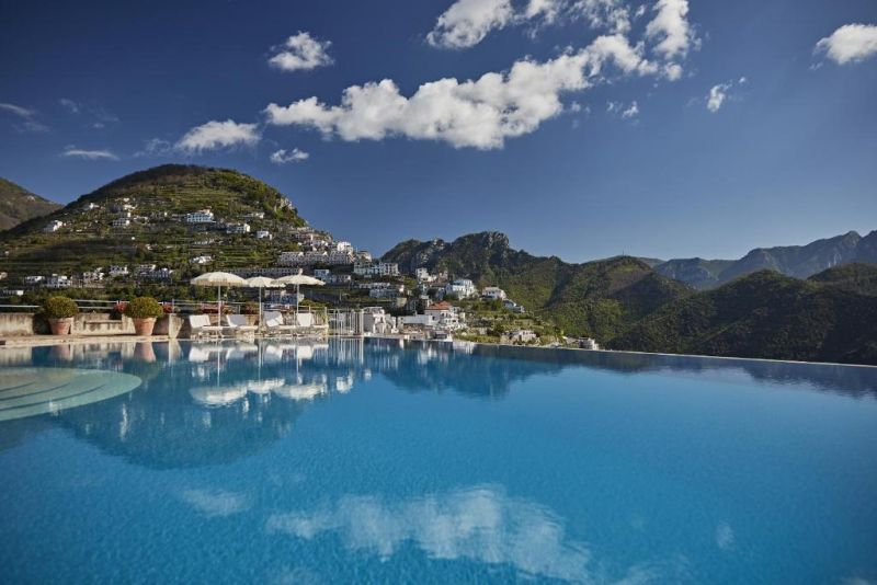 Belmond Hotel Caruso. There might be no better location to swim than the Caruso's fantastic infinity pool. Somehow set on the edge of a precipice, its blue waters blend with sea and sky to enchanting impact.