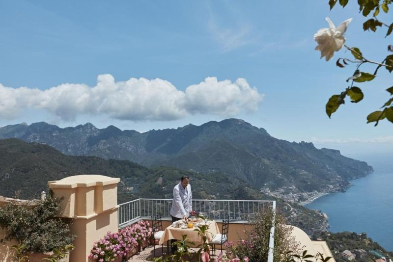 Belmond Hotel Caruso. The property includes an infinity pool, terraced gardens, and historic interiors with frescoed ceilings. The rooms and suites offer views of the garden or the sea.